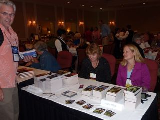 Jeanne Stein (left) and I sign our books at the Colorado Gold Conference